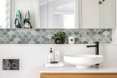 ITS ALL IN THE DETAIL.. The fishscale tile still one of our favorites that is sure to become a classic. It was the perfect choice for this…