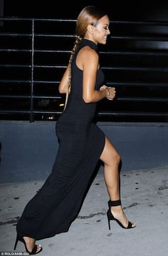 Chic: Karrueche looked stunning in a black gown with a high-cut slit up the left side