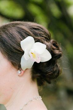 It ain't a Hawaiian wedding without hair flowers! {Photo: BluElla Photography, Venue: Kualoa Ranch Hawaii}
