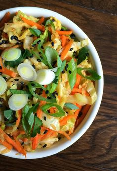 Sesame Ginger Sautéed Cabbage and Carrots - Healthy, vibrant sautéed vegetables loaded withginger and sesame. This simple side comes together in less than 20 minutes and can be adapted to any vegetables.
