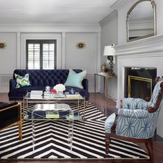 An area rug is what anchors a room, so it's the most important accessory in a well-designed living room to tie everything together.