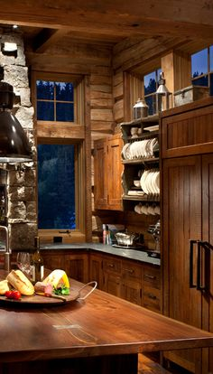 Rustic kitchen with cabinets made from reclaimed oak. Solid walnut island unit.