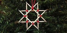Wooden Star Ornament - Use toothpicks and floss to create a minimalist Christmas ornament.