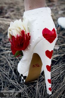 This is a set of booties to help you break hearts. Inspired by the Queen of Hearts from the famed Alice in Wonderland (and all it's variations), this is probably my most ambitious design to date. The bootie itself is white, with a checkerboard painted around the 1/2 inch platform. The heel itself is 5 1/2 inches, and has hearts painted up the back of the shoe for extra fun. The side of the boot is adorned with three half painted red and white roses the cards weren't quite able to finish.