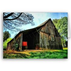 Beautiful old barn with a wagon parked inside.