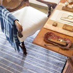 Part of our Bunny Williams collection, this delicately striped, navy indoor/outdoor rug was inspired by an antique rug sample from the designers own personal collection. Due to the handmade nature of this area rug, variations in color are expected.Made of 100% PET, a polyester fiber made from recycled plastic bottles.