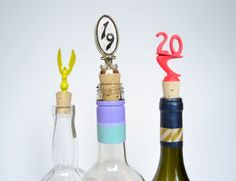 This is recycling at its finest. Made from old trophy pieces, these handmade bottle stoppers are perfect as gifts or for spring and summer cocktails parties and get togethers. Each is attached to a new cork and ready for your next party or atop one of your favorite bottles of liquor or wine.
