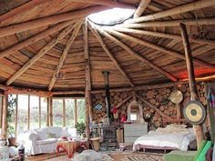 Beautiful interior of cordwood roundhouse by Plan-it Earth