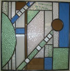 """Custom residential window designed and constructed at Stained Glass Express in Waterville, Maine. The dimensions of this multi-color abstract are 24"""" x 24"""". Artist: Lucie Boucher"""