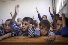 Syrian children attend class at the public school in Madaya village as classes begin in the Idlib province countryside of Syria. (AP photo)
