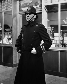 August 1940: Jack Hulbert (1892 - 1978) as a policeman in a scene from the film 'Jack's The Boy', centred around the life of a policeman in London. (Photo by Hulton Archive/Getty Images)
