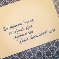 wedgwood blue ink on an ivory envelope.  lettering style: los angeles