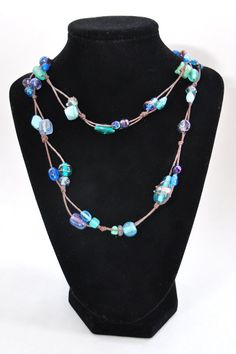 GRACE: Long Necklace with Green, Teal, and Blue Glass Beads on Brown Cord. $18.00, via Etsy.
