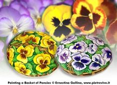How to Instructions on Painting a Basket of Pansies By Ernestina Gallina.  What you'll need for this project:  rocks   acrylic paints   brushes   Rocks suitable for this project and in general indicated for the optimal resolution of all the baskets, are round as a sphere shape, loaf shape or oval.