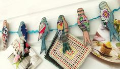 birds are attached to clothespins so you can display pictures, cards, fabric samples, artwork, etc.