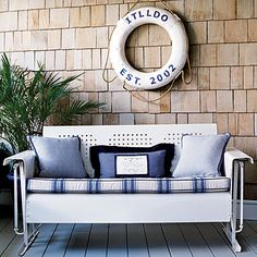 I've always wanted one of these vintage metal porch gliders and I love this blue version #exterior #decor