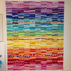 """Slopes is a quilt top! 60"""" X 72"""". Thank you @springleafstudios and @devotedquilter for your suggestions. I went with them, making and adding the top row of light purple with a little bit of pink. #slopesquilt #piecingwithstrips #stringpiecing #scrappyquilt #noscrapleftbehind #rainbowquilt via ✨ @padgram ✨(http://dl.padgram.com)"""