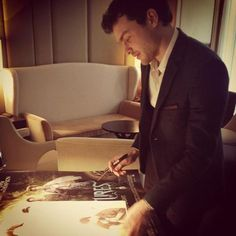 Alden Ehrenreich signs #BeautifulCreatures posters in the UK