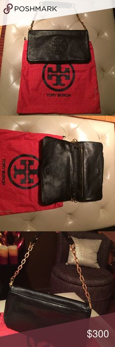 Tory Burch Reva authentic clutch Used once like new condition with Tory dust bag. Clean on the inside with two compartments. Willing to trade for a TB item. Tory Burch Bags Clutches & Wristlets