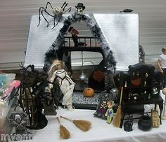 something to use old barbies for- Halloween dollhouse