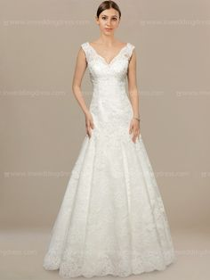 With its distinctive look and stand out textured skirt, this elegant Lace wedding dress is sure to capture all of your guests' attention as you walk down the aisle. It is the perfect style for the adventurous bride. Hand-crafted in Lace, it features a V neckline and fitted bodice. The back is securely fastened by a zipper closure with covered buttons for optimal fitting.