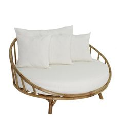 null Curl up in a comfortable Olu Bamboo Large Round Patio Daybed with Cushions. The perfect size to curl up in with a good book and a cold drink. It's crafted from a weather-resistant bamboo frame, perfect for leaving outdoors. Its cushion is foam-filled and upholstered in a poly blend, perfect for cuddling on with the included set of four polyester toss pillows. Though the cushion and pillows are great for the outdoors, we don't recommend leaving them out in the rain.About our Product…