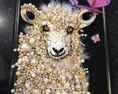 Ok this is THE BEST repurposed jewelry art I have seen yet! Kudos to the artist who created this adorable piece! ❤❤❤   Jewelry art framed jewelry art vintage jewelry art jewelry pictures jewelry picture jewelry wall art recycled jewelry art wall art sheep art