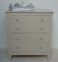 A small chest of drawers, ideal for a bedroom. We've reloved it with Farrow & Ball Oxford Stone and given it lovely porcelain handles. £85.