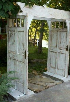 A CHARMING ARBOUR MADE WITH SALVAGED DOORS! Pretty cool.