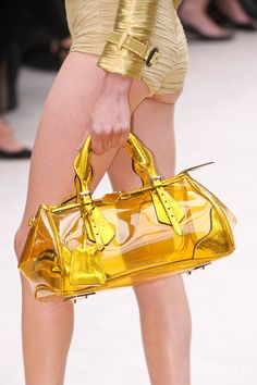 At Moschino Cheap & Chic there were chainstrap pouches shaped like pineapples