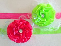 TWO neon pink and green flower headbands with curly feathers- Headband Set. $12.00, via Etsy.