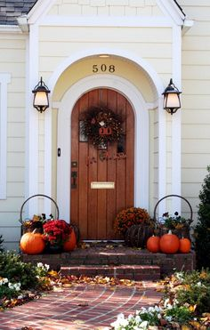 All week I've been thinking about what I can do to jazz up the front door area. It's looking pretty stark right now. I must have looked at a million different pictures in search of inspiration. I was looking for the elusive fall front door decor that had a hint of Halloween fun…but that could …