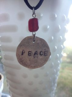 Items similar to Silver Stamped PEACE Pendant on Etsy Dog Tag Necklace, Washer Necklace, Stamp, Peace, Pendant, Trending Outfits, Unique Jewelry, Handmade Gifts, Silver