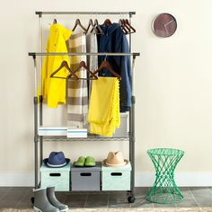 This large, double rod clothes rack is the ultimate in a moveable wardrobe organizer and storage unit. Featuring long vertical rods for hanging garments and sturdy wire shelves below for instant access to shoes and accessory items. Wire Shelving, Storage Shelves, Smart Storage, Portable Wardrobe, Wardrobe Solutions, Garment Racks, Laundry Room Storage, Closet System, Plastic Containers