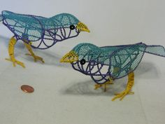 Two Matching Vintage Birds...life-size birds made of wire & wire mesh stand on their own to make interesting & fun decorations. Pose them in different ways for variety of different looks. Wonderful lively colors....hand-crafted birds will stand on any flat surface. Each bird measures approximately 9 inches long by 2 1/8 inches wide; approx. 3 3/4 high. Ships fast from metro Chicago. (0217)