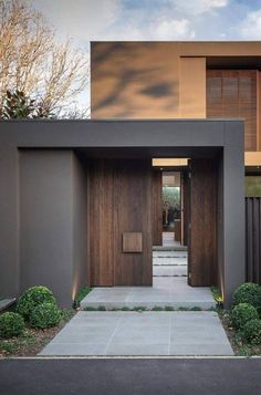 Entrance door - Bay House in Melbourne Australia by Urban Angles #modernhomeentrance