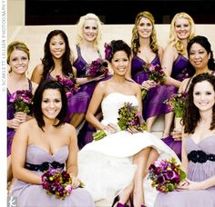 Purple Bridesmaid Dresses    Both the maid and matron of honor wore strapless,Grecian-style dresses in a light lavender shade to stand out from the other bridesmaids,who wore darker purple dresses with straps.