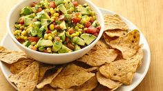 What a fun way to eat your veggies! This corn and avocado salsa is a perfect dip for Green Giant® garden ranch roasted veggie tortilla chips!