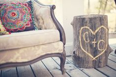 Initials carved in trees stump as wedding decor!