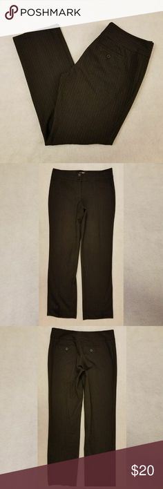 """Michael Kors Black Pinstripe Dress Pants Product Description  Brand- Michael Kors  Women's Size- 6/31  Material- 67% Polyester; 29% Rayon; 4% Spandex   A pair Michael Kors black pinstripe career dress pants. The stripes are blue and white.  They are two black pockets.  Tagged size 6/31 but please see measurements to ensure proper fit.    Outseam: approximately 36.5""""  Inseam: approximately 28.5""""  Waist laying flat: approximately 32""""  Leg Opening: approximately 7.5""""  Rise: approximately 8.5""""…"""