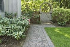 Spruce Up Your Side Yard with These Landscaping Ideas: This homeowner worked plants, hardscape, and a small patch of lawn into the side yard.
