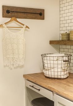 HNew Laundry Room: The Reveal! The curtain rod is a great alternative for hanging items.