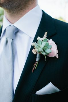 If your man is not thrilled with the idea of wearing a flower on your big day why not suggest a succulent boutonniere.