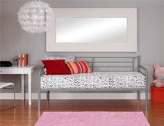 Beautifully crafted with a sturdy frame, DHP's striking twin-size Metal Daybed features curved stylish lines with simple styling. Add the matching trundle bed underneath for extra sleeping room when guests arrive (trundle bed sold separately).