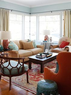 I want that chair!!!!   Light warm colors with a bold accent color in the living room