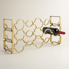 Beautifully store your wine collection in this scrolling metal wine rack. Designed to be stackable, it's ideal for shelf, countertop, cabinet or pantry storage.