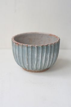 Malinda Reich Bowl no. 041 - A deep bowl in shades of pale blue and dusky white, with hand-carved fluted sides. Its shape and finish remind us of an ancient column.Friend and neighbor Malin - from QUITOKEETO.com