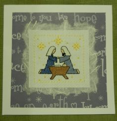 mary and joseph cross stitched christmas card.