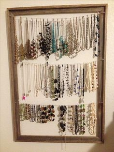 DIY Necklace Holder - maybe use a cork board instead of string or wire?
