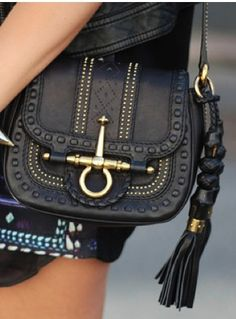 Gucci I have a purse that looks exactly like this, its Big Buddha, it costs 80 dollars... lol